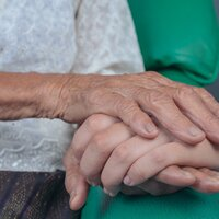 young_woman_holding_an_old_woman
